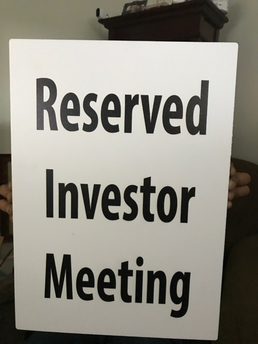 reserved investor meeting parking sign slide cover